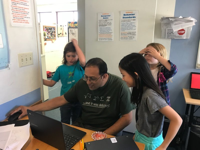 Last year's coding students try to stump Sunny with their game.